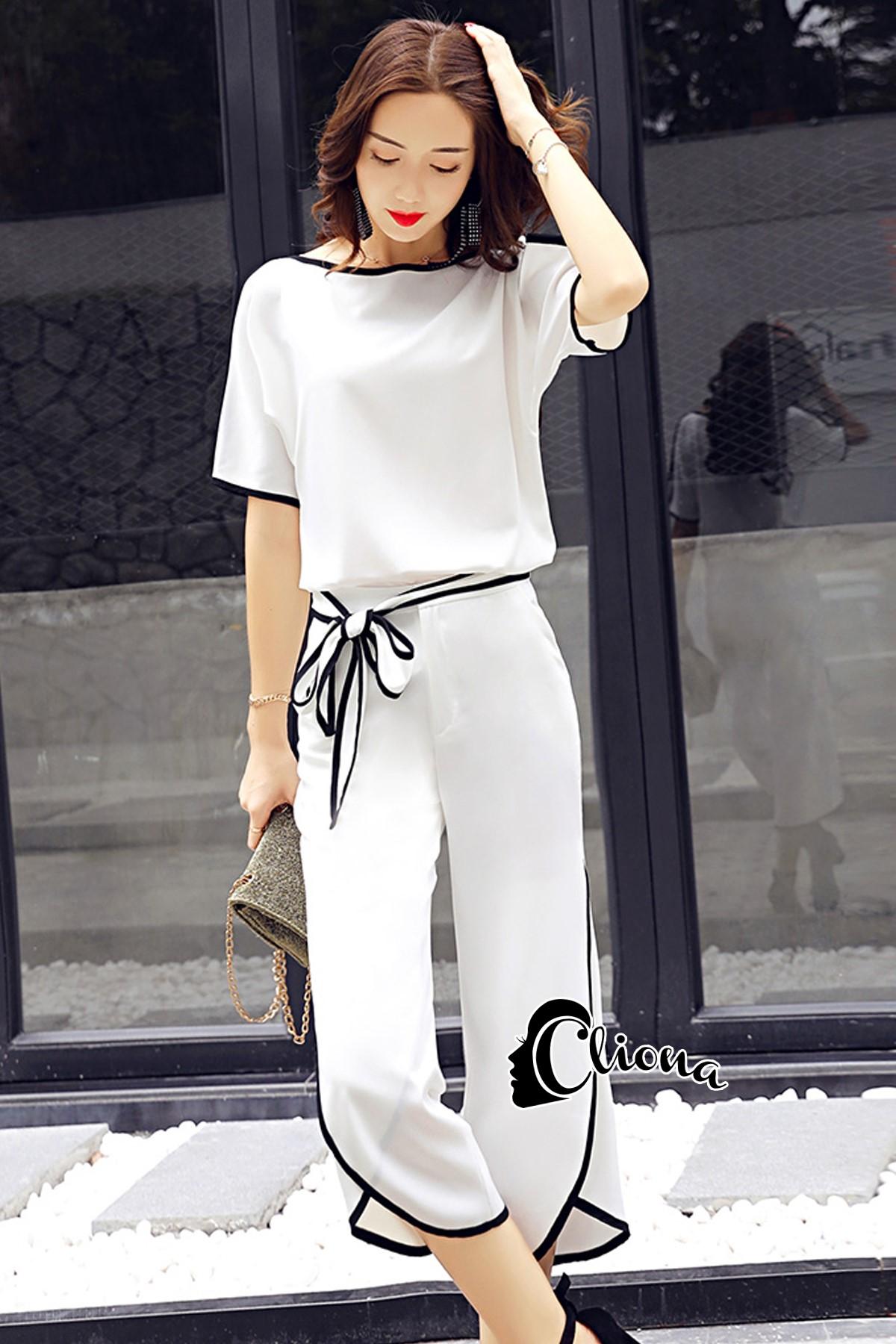 เสื้อสีพื้น ขาว/ดำ ผ้าพริ้วทิ้งตัวมีน้ำหนัก + กางเกงขาสี่ส่วนซิปข้างผูกเอว มีซับกางเกงขาสั้นผ้าเดียวกับตัวเสื้อ